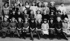 CAMBUSLANG PRIMARY SCHOOL GLASGOW (theirhistory) Tags: girls girl playground stone bench outdoors scotland beads shoes child dress boots group skirt pearls bow schoolphoto wellies railings classphoto formphoto