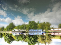 Inverted image intensifies intrinsically. (davidezartz) Tags: uk greatbritain pink blue trees light red england sky brown white black green london english water leaves yellow clouds reflections river boats grey nikon shadows image upsidedown historian character branches style surrey ripples inverted bushes rotated barges s4000 intrinsically greatphotographers thegalaxy edwardgibbon greenscene nikonstunninggallery platinumphoto ultimateshot citrit platinumheartaward uʍopǝpısdn betterthangood intensifies mygearandme nikons4000 nikoncoolpixs4000 flickrstruereflectionlevel2 flickrstruereflectionlevel1 rememberthatmomentlevel4 rememberthatmomentlevel1 rememberthatmomentlevel2 rememberthatmomentlevel3 rememberthatmomentlevel5 17371794