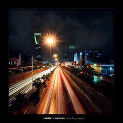 King Fahd Road after Rain [Vertorama] (Bakar_88) Tags: city longexposure urban tower cars rain weather night clouds lights vanishingpoint nikon highway perspective trails kingdom riyadh saudiarabia climate axis lightroom ksa kingdomtower cartrails autopano d90 arriyadh almamlakah kingfahdroad vertorama almammlaka