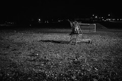 Lost (Photofidelity) Tags: nightphotography blackandwhite cold night dark lost parkinglot alone shoppingcart gravel printforsale 500px meghanherald olympusomdem5