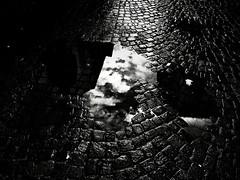 The Silence After the Storm (Yves Roy) Tags: street city shadow urban blackandwhite bw black rain contrast dark blackwhite raw moody darkness noiretblanc 28mm snap fav20 gloom yr enigmatic fav10 ricohgrd blackwhitephotos grdiii bureboke yvesroy yrphotography