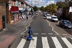 Brigstock Road (Curtis Gregory Perry) Tags: road city england urban bus london car shop traffic pedestrian clothes master rack gee crosswalk londonstreets     brigstock