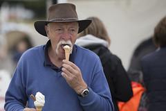 The ambidextrous ice cream eater (Frank Fullard) Tags: frankfullard fullard candid street portrait icecream ambidextrous lol fun crossmolina mayo tasch cowboyhat cowboy hat