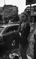 Street scenes (Helsinki Drifter) Tags: streetphotography streetportrait candid woman girl blonde eyecontact decisivemoment blackandwhite film 35mm canona1 vintagecamera underexposed pushprocess ei800 asa800 analogue selfdeveloped spontaneous snapshot citylife urban life finland socialdocumentary