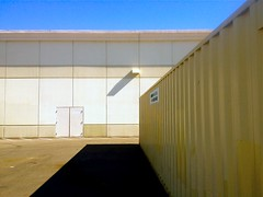 Big Box (misterbigidea) Tags: street door blue shadow sky urban building rooftop yellow retail architecture square landscape grid store big beige view box geometry empty parking cement stripe tan shapes entrance lot pale boring container shade block exit minimalism stockton slab earthtone blocky