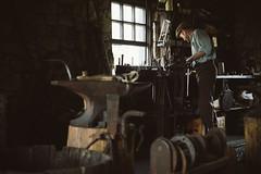 The Blacksmith (jrobfoto.com) Tags: street wood windows clamp saw raw steel olympus tools blacksmith naperville omd anvil facebook windowlight illionois em5 gplus fuji800z napersettlement tumblr microfourthirds jrobfotocom omdem5