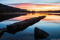 loch ard dawn (john&mairi) Tags: reflection water sunrise scotland ruins jetty scottish loch trossachs waterreflections lochard kinlochard ruinedpier yahoo:yourpictures=waterv2