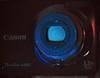 Lens Fluorescing In Shortwave UV... (Sea Moon) Tags: camera glass canon powershot fluorescent glowing ultraviolet bluegreen a480