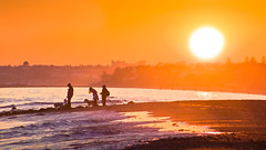 Sunset in Marbella (Hernan Piera) Tags: sunset sea people dog west sol beach relax atardecer mar fishing fisherman women mediterranean mediterraneo day waves gente playa personas arena clear perro sh