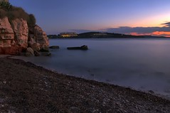 The day goes away (n.pantazis) Tags: longexposure blue sunset red sea sky color beach clouds hotel rocks solitude dusk shore deserted vouliagmeni kavouri astir pentaxk30