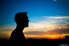 Lost In Thought (MichaelaSMillion) Tags: blue light sunset sky people orange sun man color guy colors silhouette yellow landscape outside outdoors person colorful thought day think sunny thinking land