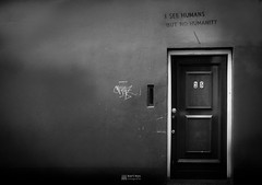 I see humans but I dont see humanity. (Bart Ros) Tags: ifttt 500px humans street photography graffiti documentary neighborhood digital photographic photojournalism graphics design urban city art door wall deventer netherlands ijssel overijssel streetphotography black and white photo