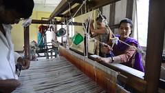 Learning the Ropes (www.WeAreHum.org) Tags: textile nepal thread bobbins gandhi tulsi ashram school for women kathmandu sowing weaving winds threads mechanical loom wood shuttles feet arts