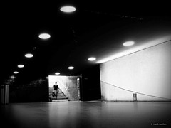 She must come through this hollow way... (Ren Mollet) Tags: aarau street streetphotography silhouette station underground unterfhrung woman door renmollet blackandwhite bw penf olympus