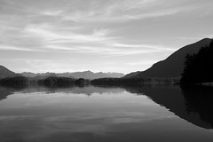Canoeing amonst the Vancouver Islands (2) (.enKay) Tags: tofino britishcolumbia canada cottage cabin woods forest sky country canon 60d wideangle landscape seascape bay water clouds reflection black white bw blackandwhite contrast horizon mountains hills countryside vacation