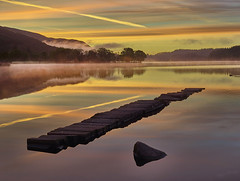 Loch Ard - Another Dawn, Aberfoyle, Scotland (ajnabeee) Tags: loch ard aberfoyle scotland dawn mist sunrise trees forest lake reflections calm mood jetty rock clouds trail orange yellow