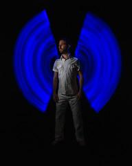 244/365 (goran1101) Tags: nikon d5100 nikkor 35mm color colour colors colours colorful man people portrait wings light neon blue painting low key
