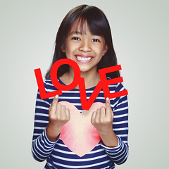 Love (Patrick Foto ;)) Tags: asian background beautiful beauty candy cheerful child childhood concept cute day emotion expression female fun gift girl happiness happy heart holding holiday isolated joy kid kids letter little love lovely people portrait present pretty red romance romantic shape sign smile sweet symbol text thai thailand valentine valentines white word young