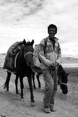 Smiling Horseman (Haomin/) Tags: voyage trip 2 summer two portrait horses blackandwhite bw india mountain lake man nature water smile smiling trekking trek walking cheval eau break noiretblanc good candid salt lac nb deux times pause himalaya été sel sourire marche ladakh homme 2012 inde 水 tsomoriri middleofnowhere horseman salted randonnée aventure 湖 爬山 jammukashmir marcher 休息 马 cheveaux tsokar salé 二 souriant rumtse randonner olympusepl2 milieudenulpart