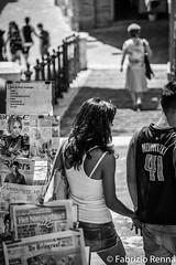 Love <3 (RennaFoto.com) Tags: macerata marche italy italia italien marchen couple young teenager twens coppia love amore liebe bw black white bianca e nera bianco nero street photography nowitzki jugend adolescente fotografia canon eos rebel t2i 18 mp cmos apsc sensor 41 holding hands mano haende halten jeans giornali newspaper zeitungen zeitung staender het nieuwsblad de telegraaf bokse riders bomboniere mygearandme