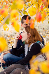 (Ole Lukoie) Tags: park autumn red portrait orange love apple nature girl beauty smile face happy couple warm bokeh joy lovers redhair leafs lovestory inlove  beautifull 50mmf14               beautifullgirl    beautifulllight aktau
