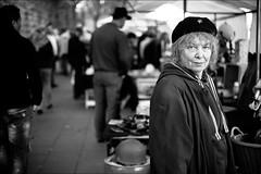 Vendor (patrickbraun.net) Tags: old portrait woman eyecontact candid cologne köln vendor seller photokina fleemarket vsco fujifilmxpro1 fujinonxf35mmf14r