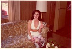 Happy Homemaker, 1975 (STUDIOZ7) Tags: woman girl fashion lady cigarette suburbia hairdo smoking livingroom clevage ashtray 1970s smoker seventies housewife furnishings haltertop homemaker