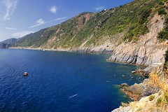 Fallen in love with the deep blue waters of Cinque Terre (Bn) Tags: family blue sea summer vacation italy woman baby holiday hot beach water colors girl sunshine swimming children relax fun coast la seaside italian topf50 rocks mediterranean italia day mare afternoon locals play liguria families joy group relaxing azure traditions down tourist tourists line resort busy bikini delight parasol grandparents towels cinqueterre bathing activity lying popular quaint monterosso tanning manarola sunbathing pleasure adriatic sunbather crowded cooling sunbeds azzurri overrun 50faves