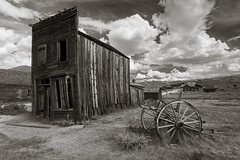 Leaning Swazey Hotel building (Xiphoid8) Tags: old abandoned wagon decay rustic ghosttown bodie cart bodieghosttown oldwagon monocounty leaningbuilding abandonedtown swazeyhotel bodiecalifornia oldcart blackwhitephotos bodieca goldtown bodiehotel monocountyca bodieswazeyhotel leaningbodiebuilding