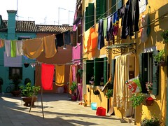 Burano colours and clotheslines (Marite2007) Tags: red italy green yellow architecture facade island vibrant vivid sunny laundry clotheslines multicolored burano veneto