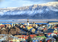 Reykjavik Cityscape in Iceland (` Toshio ') Tags: city roof winter mountain snow water buildings bay iceland colorful europe european cityscape reykjavik hallgrímskirkja icelandic toshio smokybay