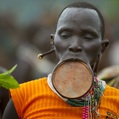 Suri Tribe Woman With A Lip Plate At A Ceremony Organized By The Government, Kibish, Omo Valley, Ethiopia (Eric Lafforgue) Tags: africa portrait people woman color square outside photography necklace dance interesting movement colorful day dancing outdoor performance ceremony jewelry tribal celebration ornament clay intriguing conflict omovalley ethiopia tribe pastoral ethnic surma bizarre impressive struggle bodymodification oneperson jewel rythm labret onepeople hornofafrica ethnology omo eastafrica suri onepersononly realpeople colorimage governement onewomanonly beautify waistup headandshoulder africanethnicity pastoralist pastoralism lipplug lipplate pacify stretchedlip kibish snnpr bodytransformation landgrabbing oneadult lipdisc southernnationsnationalitiesandpeoplesregion kibbish piercedhole piercedlipornament ethiopianethnicity enlargedearlobe eth7058