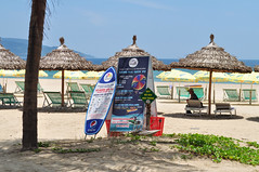 Just add people (Roving I) Tags: quiet deserted beaches whitesand thatch shelter sunprotection sea umbrellas activities workers kitesurfing surfboards signs tourism travel palmtrees danang vietnam
