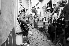 Have a nice day (Georgi C) Tags: talin estonia voigtlandernoktonclassicf14 sony street streetphotography bokeh dof streets streetshadows contrast guitar streetperformance music people lonelypeople