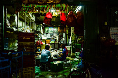 Family Life (Ben Duursma) Tags: family eating east eats sitting sits generations contrast bangkok thailand asia red bags crates flower market nikon d7000 18105mm shadows travel photography urban city youngphotographers photojournalism