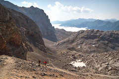 hiking (JuanCarViLo) Tags: picos europa spain mountain valley clouds hike sunray red sea snow track national park