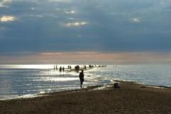 A walk out to the sea on the sand dune (KaarinaT) Tags: kalajoki finland sanddune beach light lightpeekingthroughtheclouds diamondsonthewater sparklysea people sea water peoplewalkingtothewater sandybeach