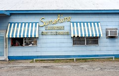 Sunshine Laundry Dry Cleaners (Rob Sneed) Tags: usa texas elcampo whartoncounty sign cursive wooden painted script sunshinelaundrydrycleaners cleaners independent locallyowned drycleaning clothing smalltown americana texana advertising commercial professional laundry repairs sewingmachines awning windows ac friedrichairconditioning windowunit