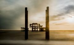 West Pier (craig_2001_2002) Tags: pier brighton sea longexposure beach sunset waves clouds mist storm