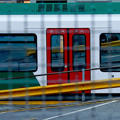 Clandestino. Clandestine ( fences/barriers) (sandroraffini) Tags: treno train barriera grata fence grid clandestinity peek desire railway station immigration authorized urban details minimalism minimalismo psicogeografia exploration travel yellow red white green reflections distortions blur social bologna sandroraffini without ticket square italia italy hope life denied pov lines curves