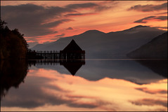 Crannog Loch Tay (angus clyne) Tags: road camera autumn boy sunset cloud mist mountain lake reflection tree bird fall forest canon dark lens island drive scotland pier boat town duck haze long