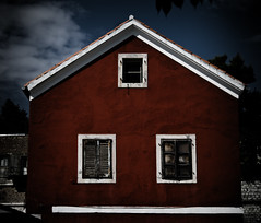 There's a red house (Selena Sheridan) Tags: windows red white house colour three stormy shutters attic zadar