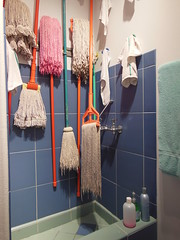 mops for all seasons (Just Me 101) Tags: pink blue wet water colors tile grey soap sink bottles rags teal cleaners magenta dry towel hose faucet mop moisture damp detergent mops