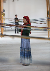Uyghur Worker In A Silk Factory, Hotan, Xinjiang Uyghur Autonomous Region, China (Eric Lafforgue) Tags: china travel people woman man industry tourism vertical scarf person photography clothing day muslim traditional headscarf working chinese perspective craft indoor line textile hotan uighur xinjiang silkroad worker daytime inside uyghur weaver cloth youngadult minority weaving 2people twopeople weave youngwoman anthropology loom silkfactory ethnicity sociology peoplesrepublicofchina autonomy dayview turkic humanright uygur ouigour twopersons colorpicture adultonly colourimage ethnicgroup xinjiangprovince colourpicture xinjianguyghurautonomousregion traditionallychinese easternandcentralasia turkicethnicgroup uygurethnicity eti0686 womanjeanskirt