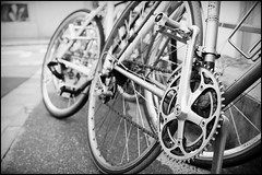 Bikes behind Ometesando Hills (Eric Flexyourhead) Tags: city urban bw detail bike bicycle japan tokyo blackwhite bokeh shibuya chain   omotesando fragment shimano cranks   shimano600 chainrings crankset jingumae shibuyaku olympusep1 panasoniclumix20mmf17