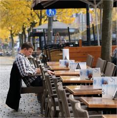 Waiting for the Waiter (Hindrik S) Tags: boy man table 50mm chair waiting terrace sony herfst tamron stoel cpf f28 terras waiter leeuwarden tafel a300 liwwadden ljouwert nieuwestad dikkevandale tamron1750 sonyalpha tamronspaf1750mmf28xrdiiildasphericalif nijstêd dslra300 α300 alpha300 sonyphotographing hjerst