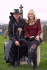 7D0020a Man & Woman in Church Yard - Whitby Goth Weekend 3rd Nov 2012 - Copy (gemini2546) Tags: nov goth week 3rd red 2470 silver canon sigma leather hair 7d lens church handle yard top hat coat boots blond whitby 2012 lady black man cane graves