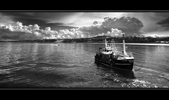 Scarborough Scalloper (Michael~Ashley) Tags: england white black beach clouds mono boat seaside fishing scallops scarborough trawler