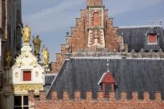 Roof line of Bruges (jcm715) Tags: city roof urban colour building brick rooftop window skyline architecture tile gold europe european belgium belgique brugge ornament bruges baroque roofline gilt
