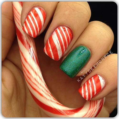 Candy Cane Tape Mani ❤❤❤ #holidaymani #winternails #nails #candycane #candycanenails #christmasnails #glitter #nailswag #nails2inspire #nailartoohlala @nailartoohlala @nails2inspire #nailartclub #nailsofinstagram #lacquerhead